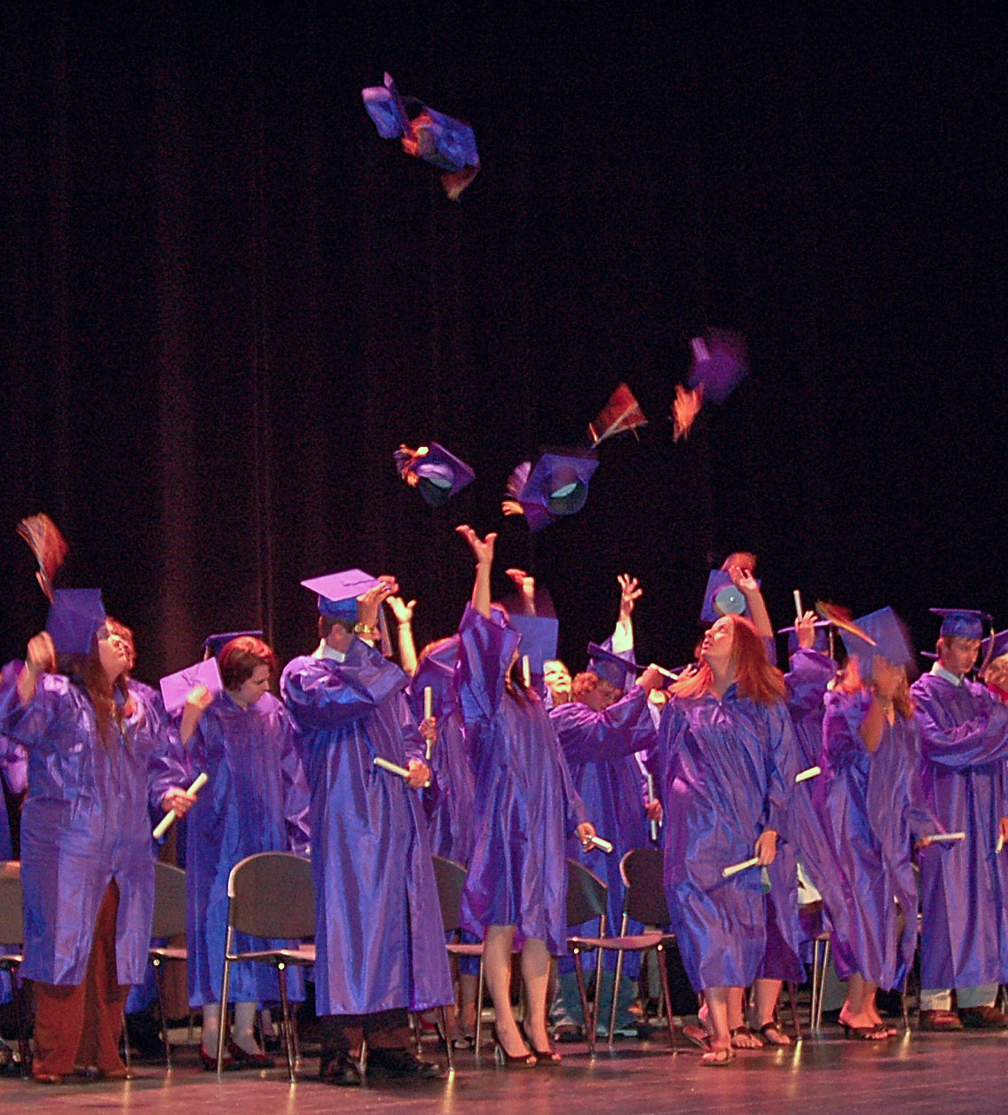 Seniors toss their hats